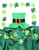 Saint Patrick day hat with clover leaves and golden coins, isolated on white — Stock Photo