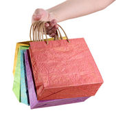 Colorful shopping bags in female hand, isolated on white — Foto de Stock