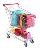 Colorful shopping bags in shopping trolley, isolated on white — Stock Photo