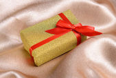 Gift box on table close-up — Stock Photo