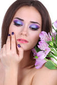 Beautiful young woman with flowers close up — Stock Photo