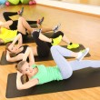 Stock Photo: Group of young people engaged in gym