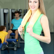 Young beautiful woman in gym — Stock Photo