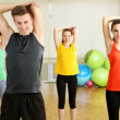 Stock Photo: Young beautiful peoples engaged in gym