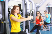 Group of people training with weights in gym  — Stock Photo