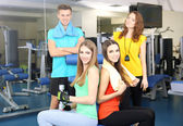 Group of people relaxing after training in gym  — Stock Photo
