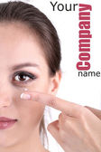 Young woman putting contact lens in her eye close up — Stock Photo