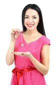 Attractive young woman with pendant in hands isolated on white — Stock Photo