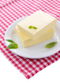 Tasty butter on plate, isolated on white — Stock Photo