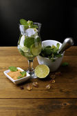Ingredients for lemonade on wooden table, on grey background — Stockfoto