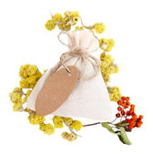 Textile sachet pouch with dried flowers, herbs  and berries, isolated on white — Stock Photo