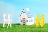 Little house on green grass, on blue sky background — Stock Photo