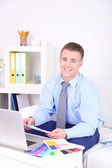 Young creative designer working at home — Stock Photo