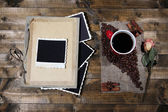 Composition with coffee cup and photo album, on wooden background — Photo