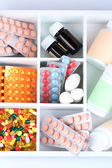 Medical pills, ampules in wooden box, close-up — Stock Photo