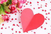 Paper heart with flowers on bright background — Stok fotoğraf