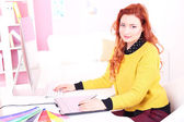 Young woman graphic designer working using pen tablet in workplace — Stock Photo