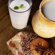 Stock Photo: Eggnog with milk and eggs on table