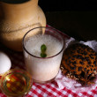 Stock Photo: Eggnog with milk and eggs on tablecloth