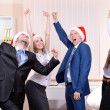 Successful young businesspeople at Santa hat at office — Stock Photo #41861209