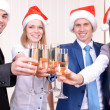 Successful young businesspeople at Santa hat at office — Stock Photo #41861223