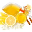 Sweet honey with lemon isolated on white — Stock Photo