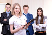 Successful young businesspeople at office — Stock Photo