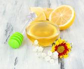 Sweet honey on wooden table — Stock Photo