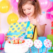 Pretty little girl celebrate her birthday — Stock Photo #41891421