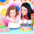Pretty little girl with mom celebrate her birthday — Stock Photo #41891425