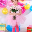 Pretty little girl with flowers celebrate her birthday — Stock Photo #41891471