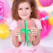 Pretty little girl with gift celebrate her birthday — Stock Photo #41891503