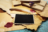 Composition with blank old photos, paper, letters on color wooden background — Foto Stock