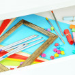 Stock Photo: Colorful paper in open desk drawer close up