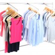 Different clothes on hangers, on gray background — Stock Photo #42010033