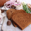 Rye bread with lard and onion on table close up — Stock Photo #42010501