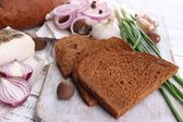 Rye bread with lard and onion on table close up — Stock Photo