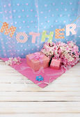 Mother- lettering of handmade paper letters on blue background — Stock Photo