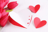 Paper hearts with flowers close up — Stock Photo