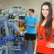 Stock Photo: Young beautiful girls in gym