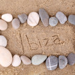 Inscription Ibiza in wet sand close-up background — Stock Photo