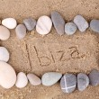 Inscription Ibiza in wet sand close-up background — Stock Photo #42229197