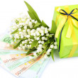 Stock Photo: Gift box with money and flowers isolated on white