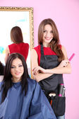 Beautiful girl hairdresser and client in beauty salon — Stock Photo