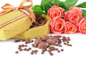 Delicious chocolates in box with flowers close-up — Stock Photo