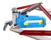 Construction stapler and wooden frames isolated on white — Stockfoto