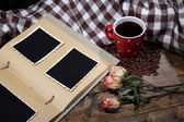 Composition with coffee cup, decorative hearts, plaid, and photo album, on wooden background — Stok fotoğraf