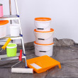 Stock Photo: Buckets with paint and ladder on wall background. Conceptual photo of repairing works in room