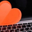 Stock Photo: Red heart on computer keyboard close up