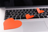 Red hearts on computer keyboard close up — 图库照片